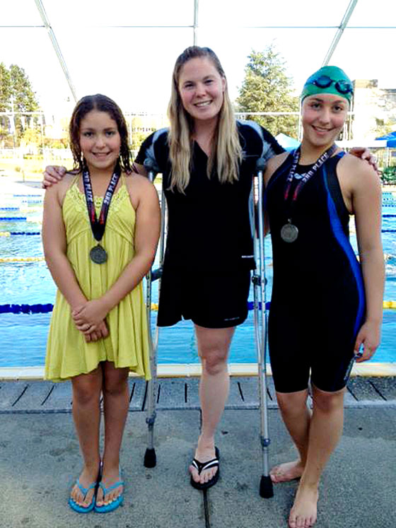 whitehorse daily star  swim sisters star at aaa long
